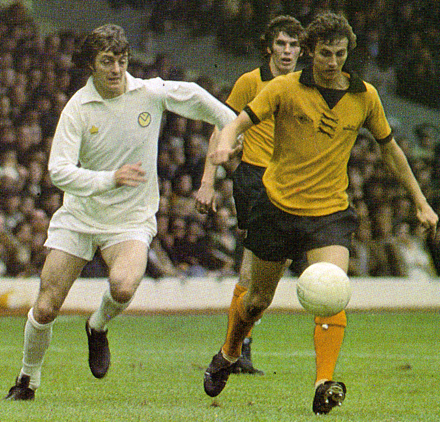 Powell on the ball and under pressure from Allan Clarke in Wolves' game at