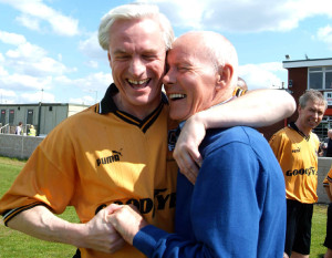 A friendly Noose Lane hug for Barry in recent years from Mel Eves.