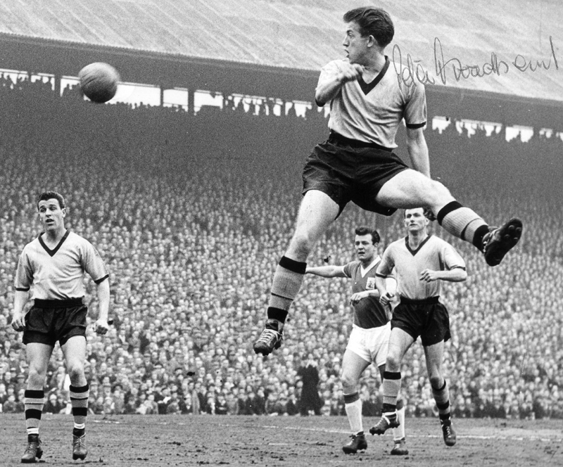 Peter Broadbent sends a header at Birmingham's goal at a packed St Andrew's in 1957. Watching him are Harry Hooper (left) and Jimmy Murray.