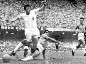 Broadbent is tackled by Brazil's Nilton Santos in Rio de Janeiro.