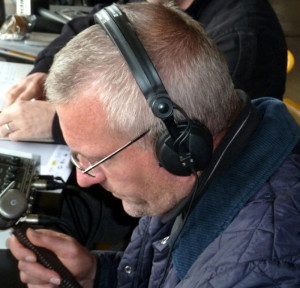 Tim Flowers attired in headphones, rather than goalkeeper gloves.