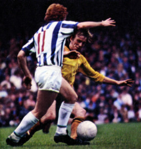 Bertie Lutton is challenged by Huddersfield's Colin Dobson at Molineux in 1970.