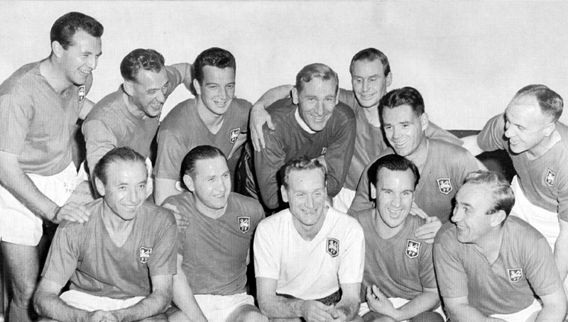 Billy Wright (front row, far right) in a jovial group at the testimonial game of centre-of-attention Tom Finney.