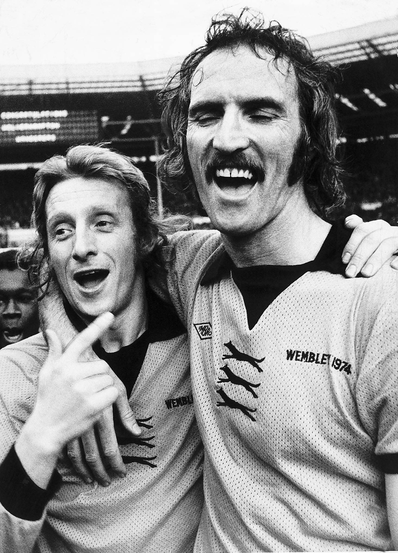 Two of football's ultimate showmen in Wembley embrace.....Denis Law (in Frank Munro's shirt) and Derek Dougan.
