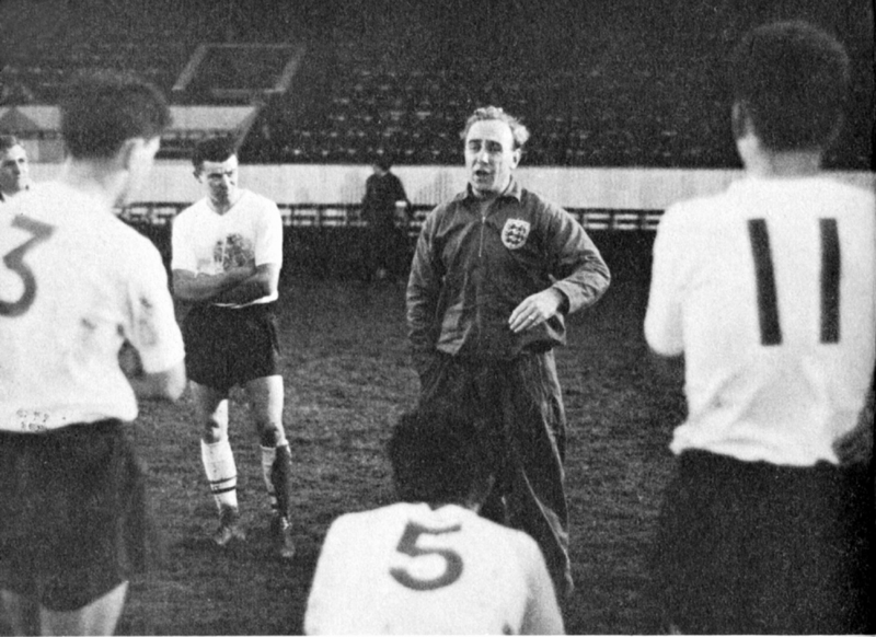 Billy Wright conducts an England training session in front of Dick Le Flem (number 11), Gordon Jones (3), Brian Labone (5) and Johnny Byrne.