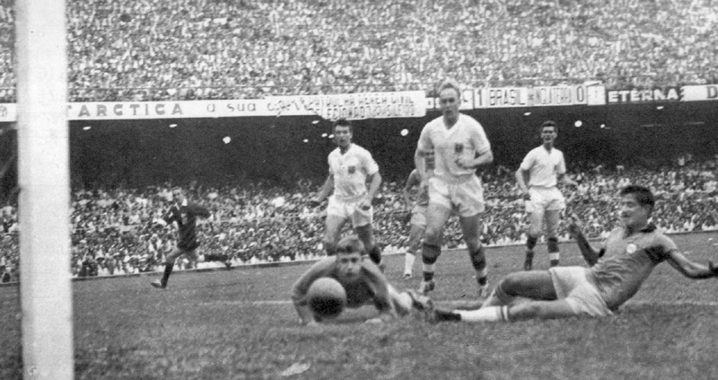Against an unbelievable backdrop, Billy Wright watches Henrique score Brazil's second goal at the Maracana in 1959.