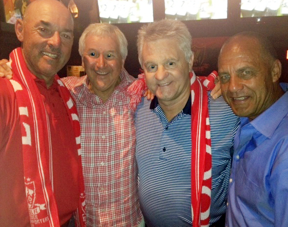 Les Wilson (one in from the left) with former Whitecaps charges Bruce Grobbelaar, Alan Errington and Carl Valentine.