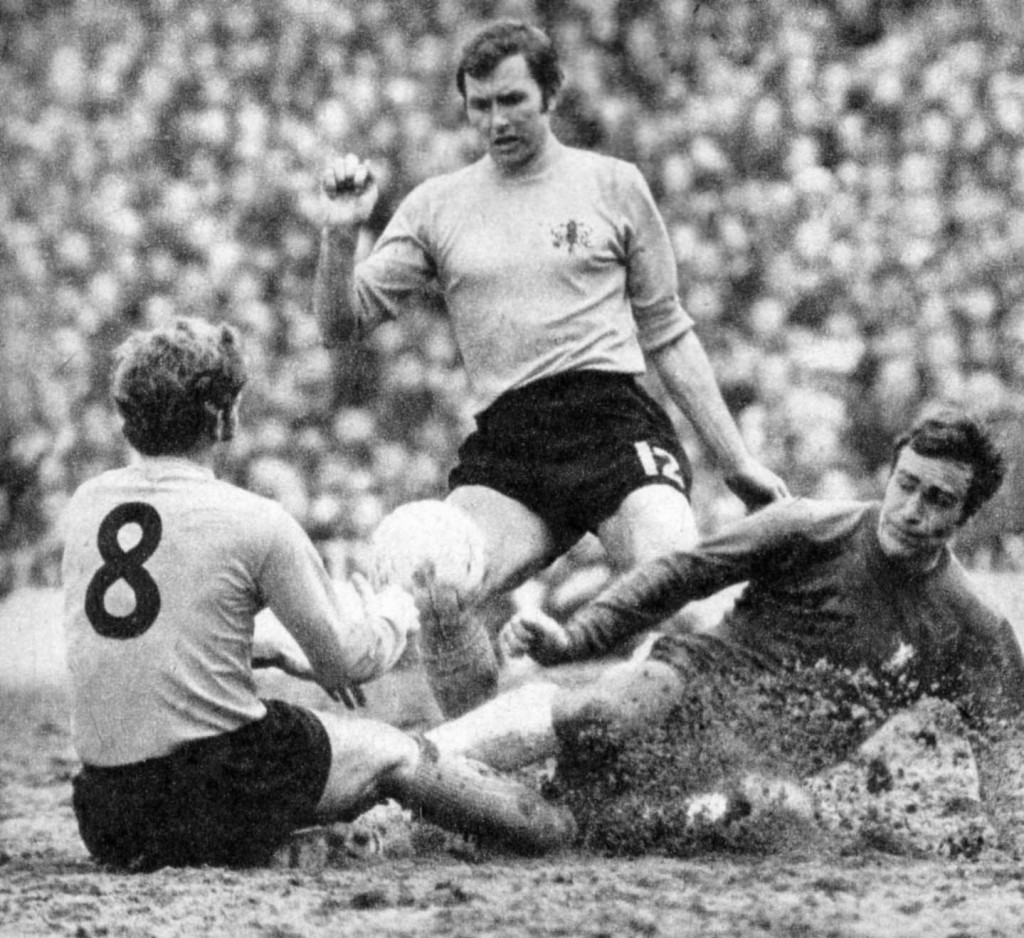 Brian (standing) appearing as sub for Watford against Chelsea in the 1970 FA Cup semi-final against Chelsea in the mud of White Hart Lane. Ron Harris is the opponent.