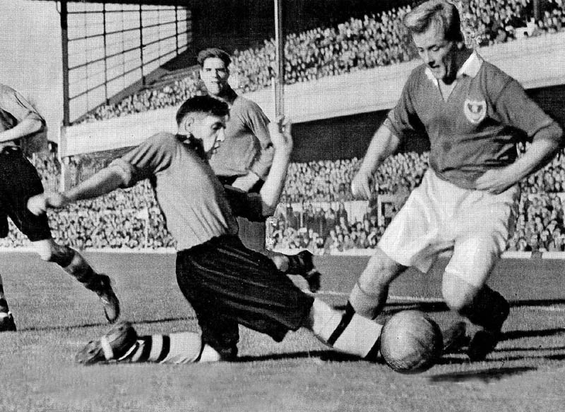 Bill Shorthouse slides in on his opponent in the 1949 Charity Shield at Highbury.