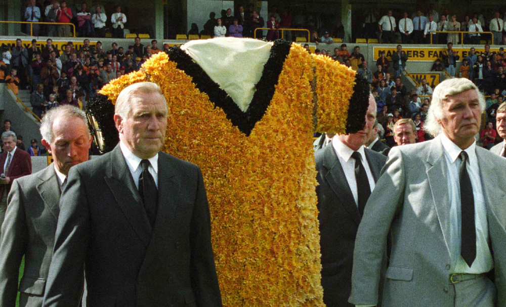 Not a dry eye in the house....Bill Shorthouse (left) and Eddie Stuart lead the way with a Wolves shirt made from flowers at the first home game after Billy's passing.