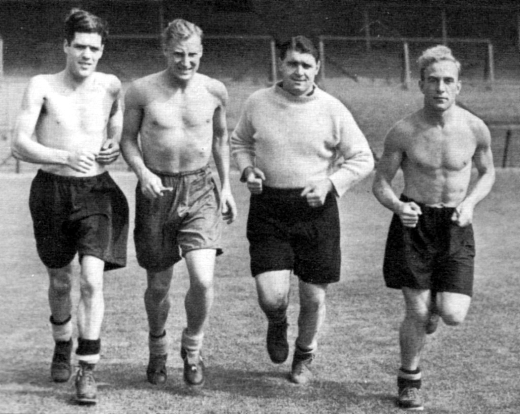 Angus McLean seems to be feeling the cold as he trains with (from left) Lol Kelly, Bert Williams and Billy Wright.