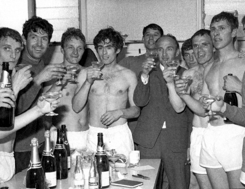 Bill McGarry, Sammy Chung, Ray Crawford and Danny Hegan celebrate among friends as the promotion champers is poured at Ipswich in 1968.