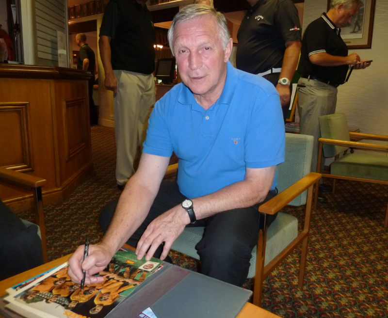 Time for the autograph seekers......Gerry Taylor signs.