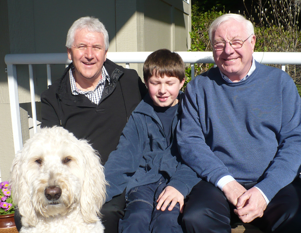Alan Hinton (right) and his grandson Matteo at a get-together in recent years with Les Wilson and golden doodle Scholesy.
