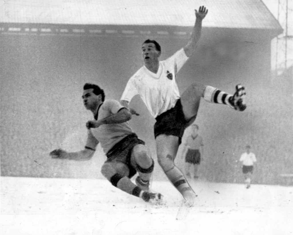 A skirmish in the Molineux snow with Bolton's Nat Lofthouse.