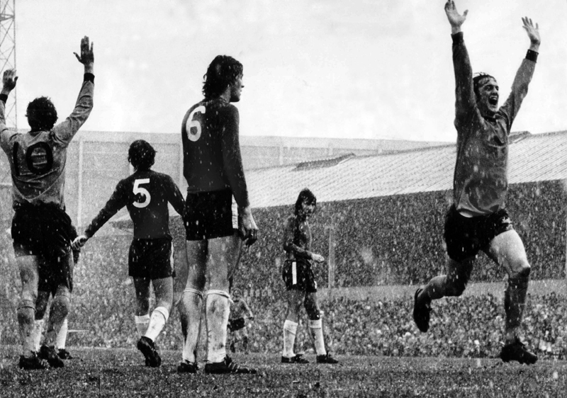 Alan Hudson peers gloomily through the snow as Wolves celebrate a Kenny Hibbitt goal against Chelsea at Molineux in February, 1971.
