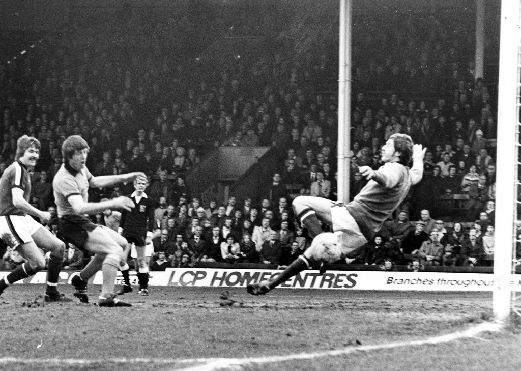 John Richards scores at home to Hereford in March, 1977.....much to the disappointment of former Wolves defender Derek Jefferson (left).