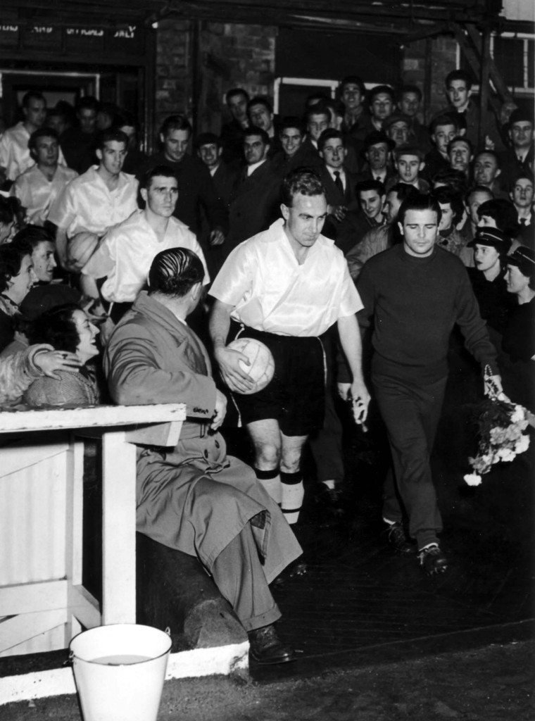 The big entrance....Honved in tracksuits, Wolves in the satin, fluorescent shirts they had developed for use in the winter gloom.