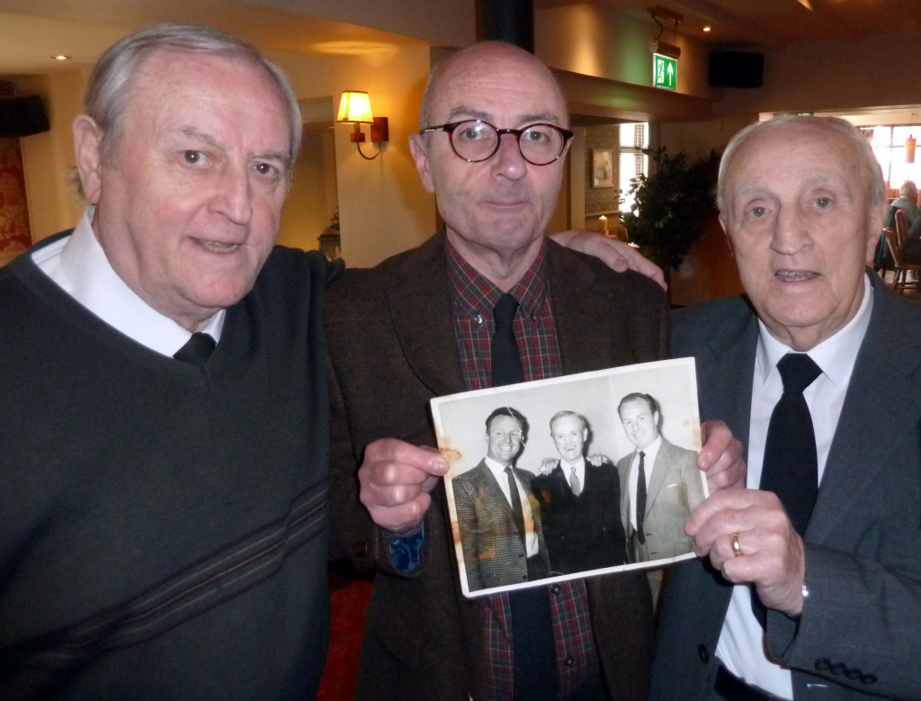 Jimmy Dunn's surviving brothers David (left) and John are joined by the late Wolves player's youngest son Peter (centre) in showing off a valuable family keepsake.....a photo showing Jimmy (left), his Scottish international star father and (right) Tommy Dunn.