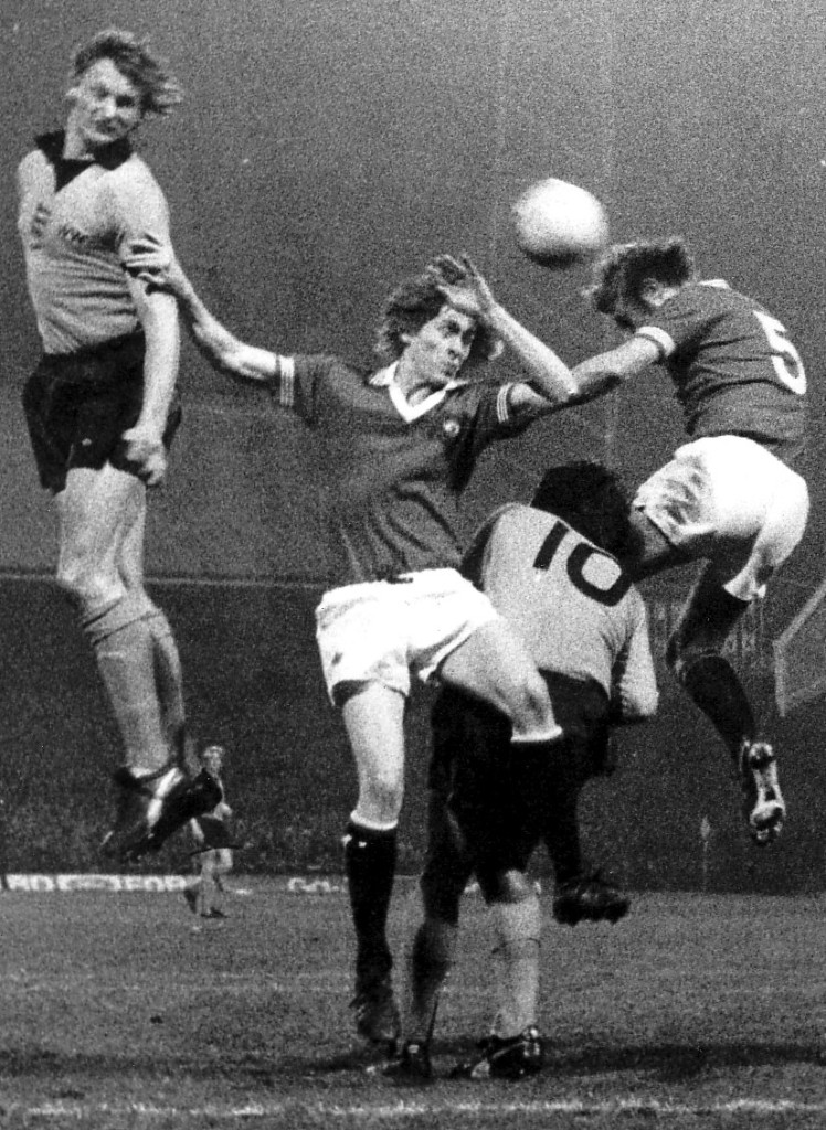 Steve Kindon challenges on the 1976 night that goals by he and John Richards gave Wolves a 2-0 lead that Manchester United overturned in an FA Cup quarter-final replay in front of more than 44,000 at Molineux.