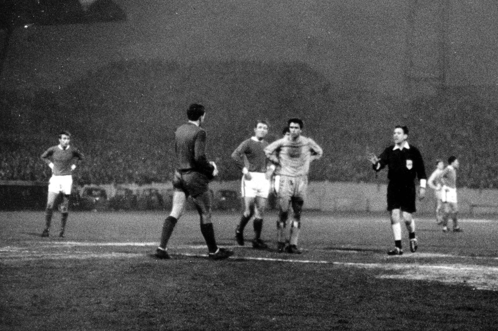An unsympathetic Bobby Gould looks on as Alan Hill troops off injured, to be replaced by Rotherham's centre-forward.
