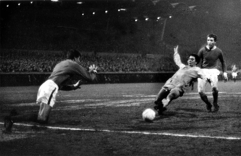 John Galley prepares to dive at Bobby Gould's feet at Highfield Road - but a penalty has already been awarded.