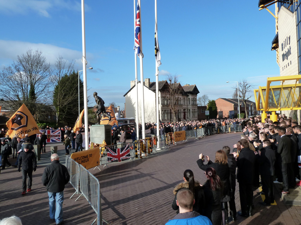 A picture of respect and pride as the cortege heads for the city centre.