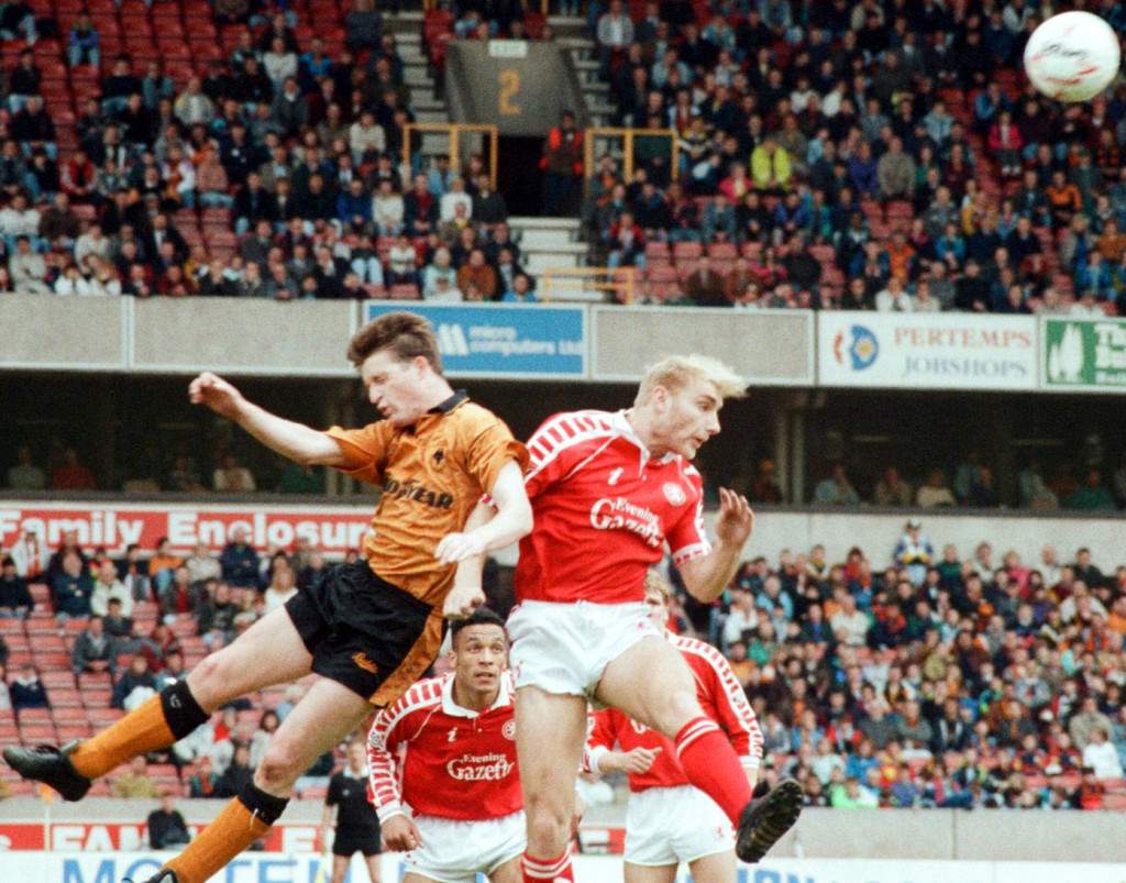 Andy Mutch, later to open the scoring with a header, challenges Stuart Ripley for a high ball.