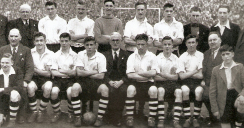 Colin Booth (in blazer, front right) with an England Schoolboys squad also containing Eddie Clamp (player on far left of back row) and Johnny Haynes (in front of Eddie's left elbow). Kneeling on the far left is Frank Blunstone while the last but one player seated is Ray Parry.