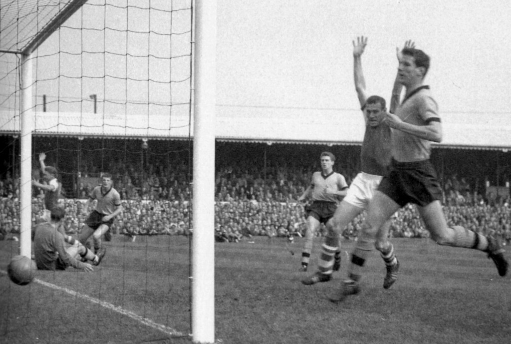 The back-tracking Duggie Woodfield is powerless to stop a shot from Doug Moran (far left) opening the scoring at Portman Road. Bobby Thomson is the other defender close at hand.