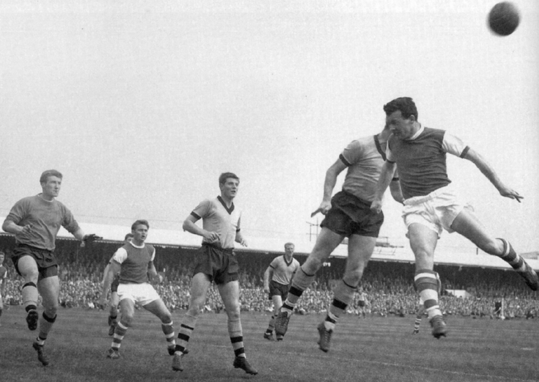 Fred Davies, Freddie Goodwin and the leaping Dave Woodfield, watched by a more distant Ron Flowers, help Wolves resist an Ipswich corner 52 seasons ago.
