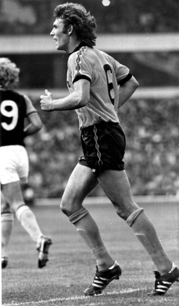 John McAlle keeps tabs at Villa Park on Andy Gray....an opponent who would become a team-mate.