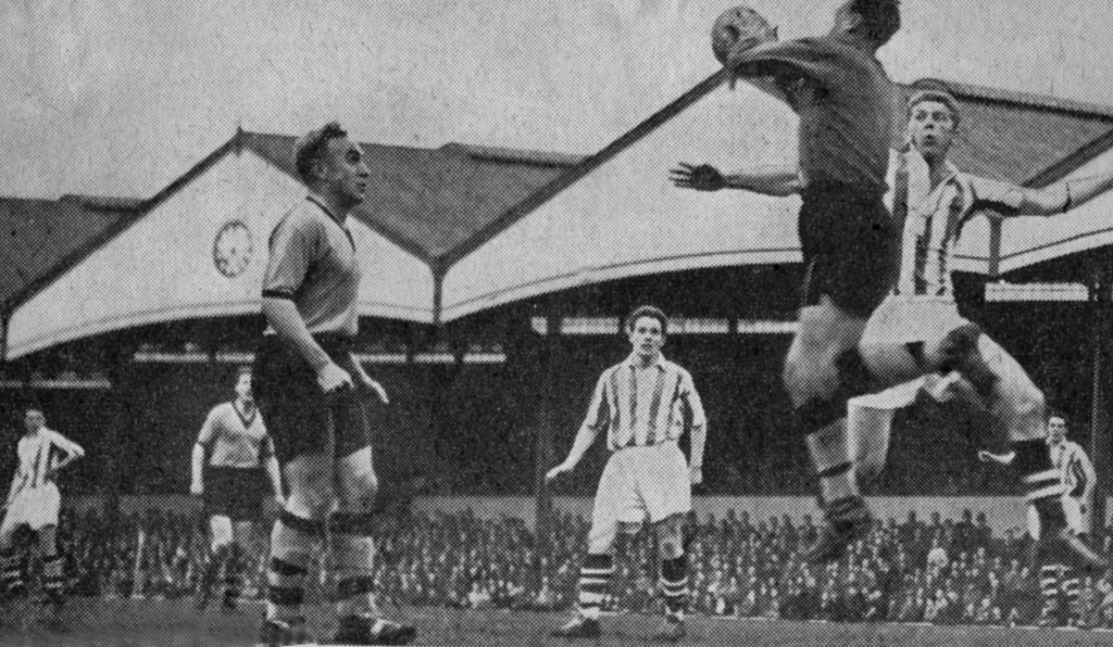 Bert Williams, watched by Billy Wright and a stripe-shirted Roy Horobin, denies Albion forward Derek Kevan in Wolves' 5-2 Monday night home win in the Black Country derby in April, 1957.