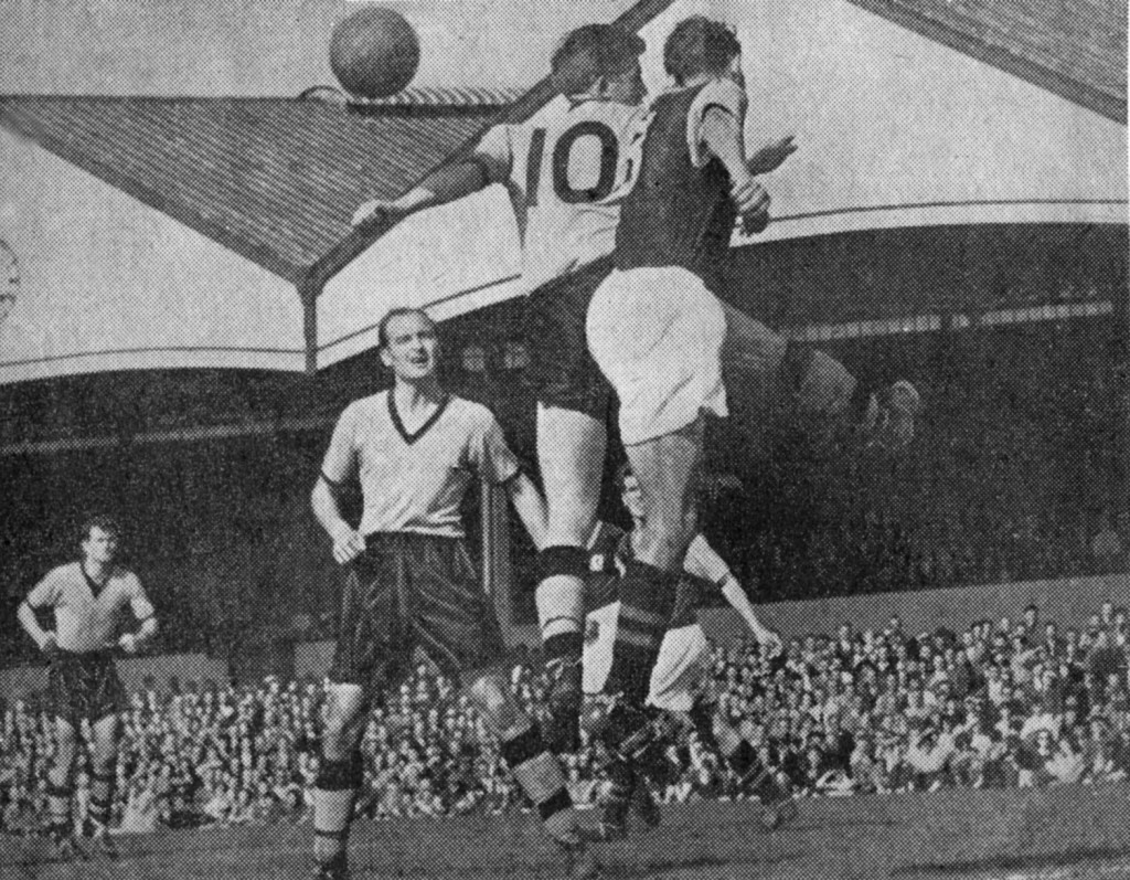 And now it's Villa on the receiving end as Wolves gain immediate revenge for a 4-0 thrashing at Villa Park by winning 3-0 in the Molineux return the following evening. The two-goal Peter Broadbent is supported here by fellow scorer Dennis Wilshaw, with Jimmy Murray in the distance.