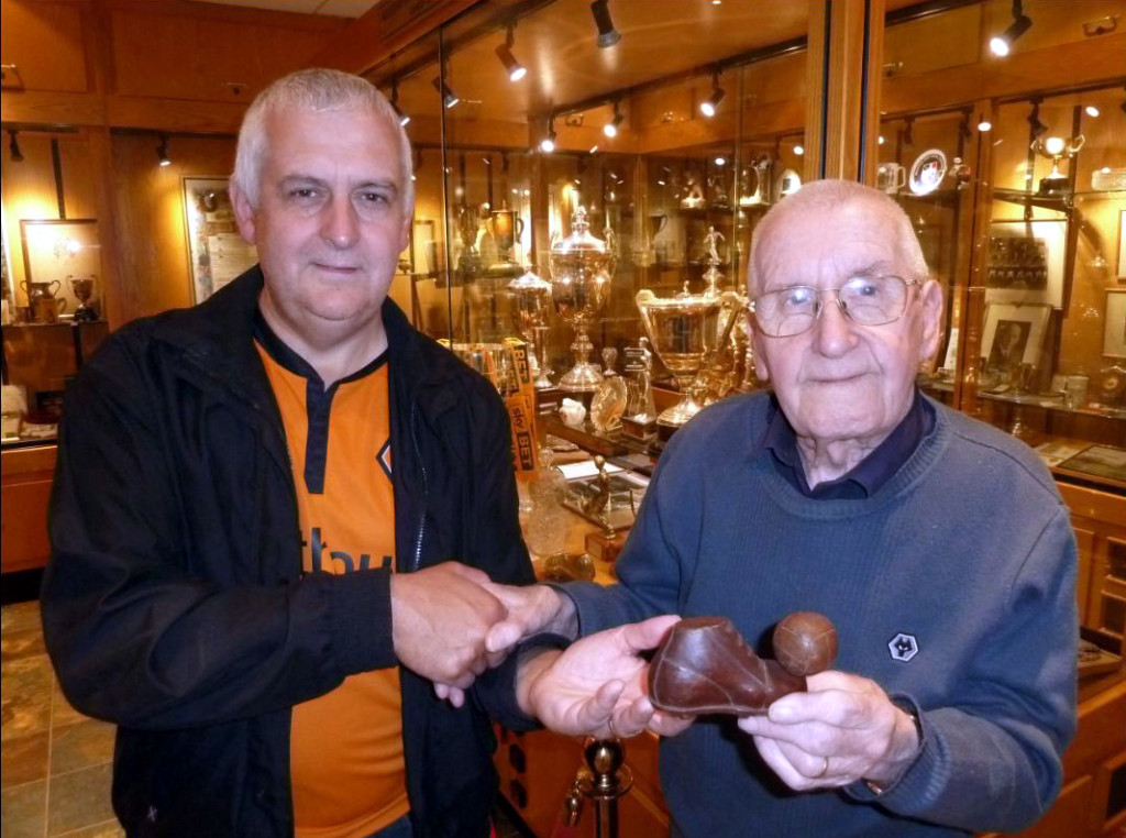 Simon Clarke hands the boot over for safe keeping at Molineux to Graham Hughes.