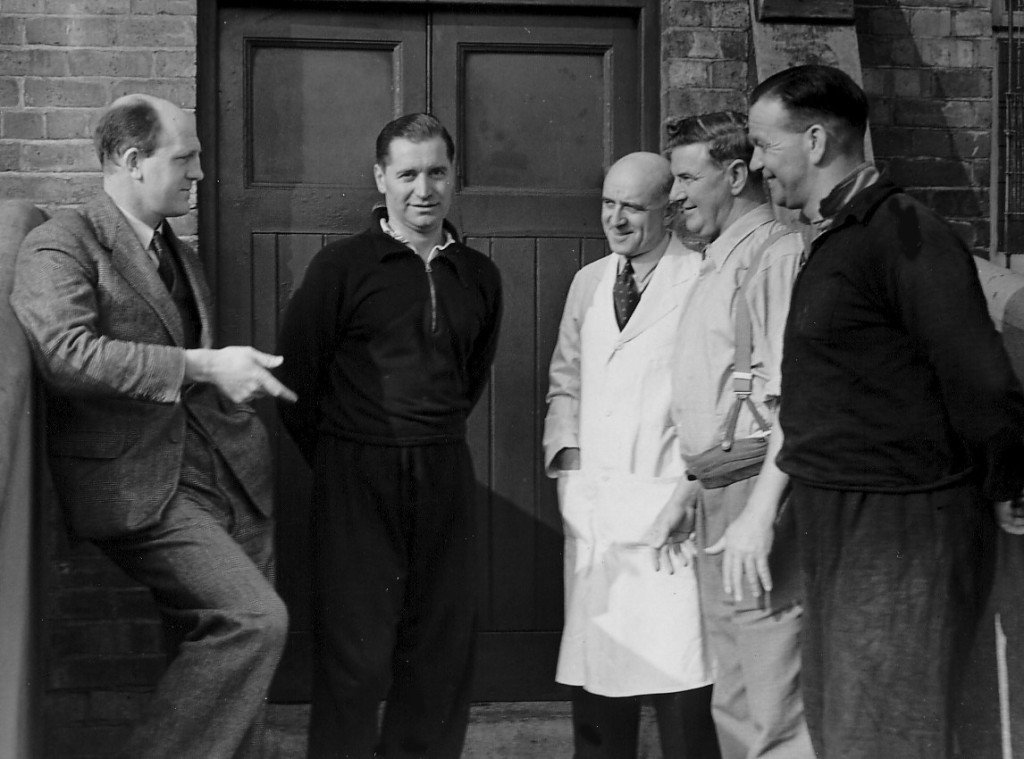 Jack Dowen (far right) listens in on a briefing from the recently appointed Stan Cullis, along with (from left) Joe Gardiner, physio George Palmer and Jack Davies.