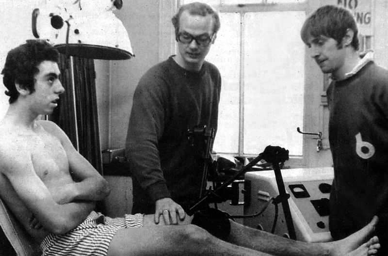 Brian Owen, who these days runs a private physio practice, watches Toby Andersen at work in the early 1970s with a nattily (un)dressed Geoff Palmer.