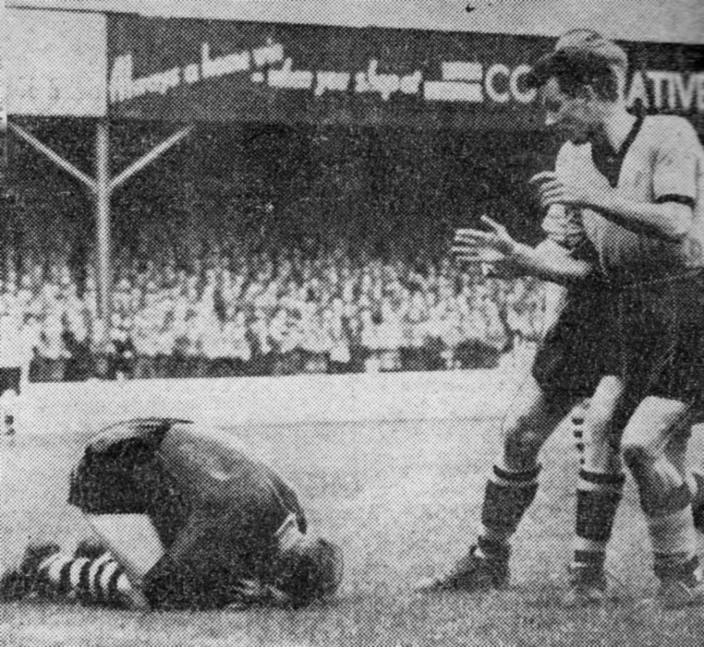 Harry Hooper, in his first away League game for Wolves, is denied at Kenilworth Road by keeper Bernard Streten.