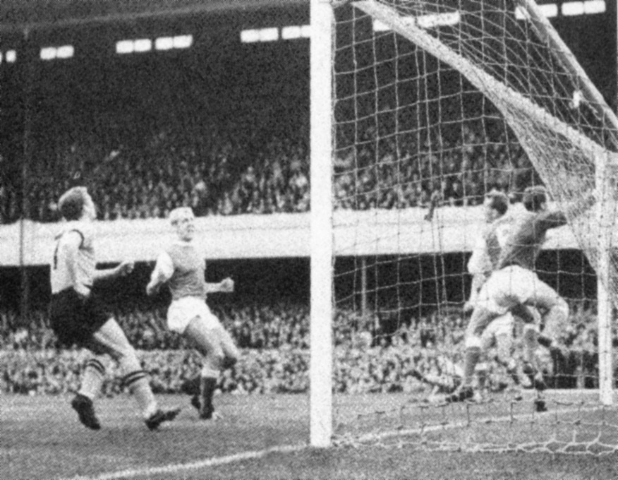 Terry Wharton closes in as an effort from Ted Farmer hits the woodwork in Wolves' opening-day win at Arsenal in 1963-64.