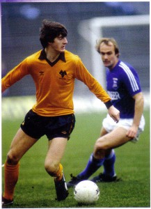 Wayne Clarke in action against Mick Mills and Ipswich.