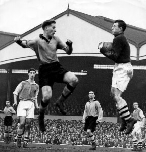 Challenging Arsenal keeper Jack Kelsey in a game at Molineux in January, 1955.