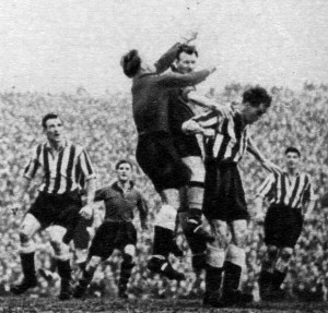 Action from the controversial Newcastle v Wolves semi-final in 1951 as Jimmy Dunn challenges keeper Fairbrother.