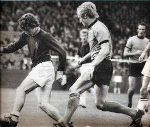Derek Parkin moves in to tackle Dave Thomas - familiar in having his socks rolled down - in Wolves' 3-2 win at Burnley in September, 1970.