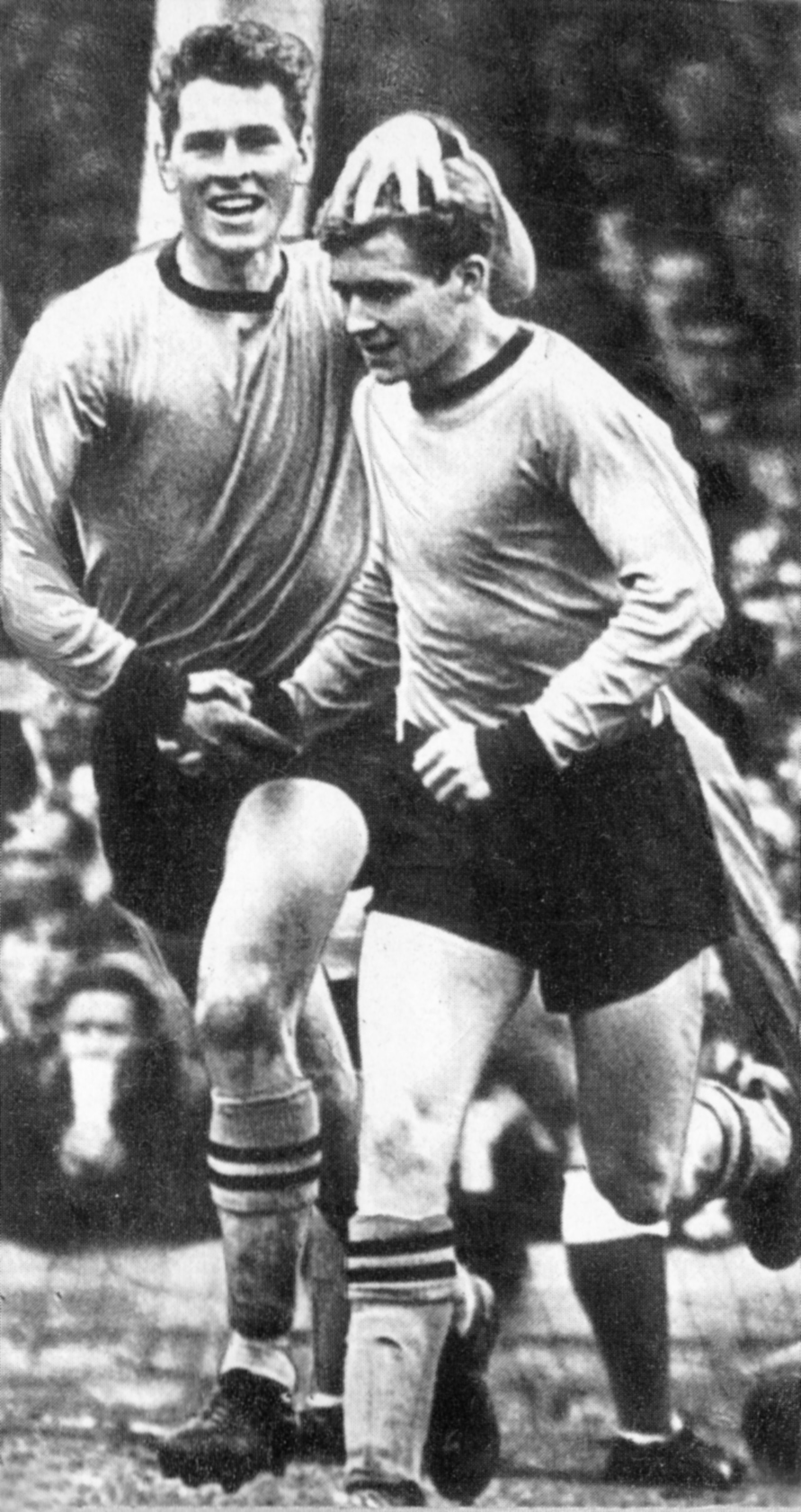 Ray Crawford and Terry Wharton celebrate a Wolves goal.