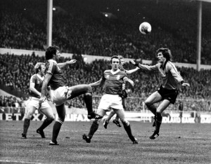 Kenny Burns (Left) looks on as Dave Needham clears at Wembley from Mel Eves.