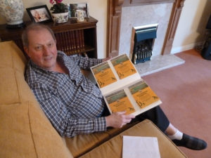 John Doughty at home with his memorabilia.