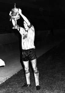 Cup-winning captain.....displaying some modest silverware to 2,000 or so in the John Ireland Stand.