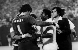 Parkes is congratulated by Pele after facing him in America.