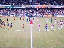 West Ham and Wolves players observe a minute's silence at Upton Park following the death of Bobby Moore in 1993.