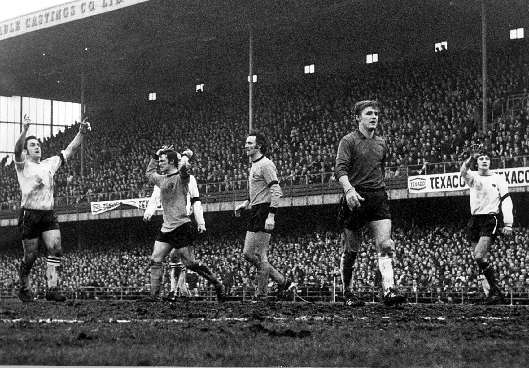 Roy McFarland (far right) about to breathe a sigh of relief as Wolves have a goal disallowed on the Baseball Ground mudheap in January, 1971.